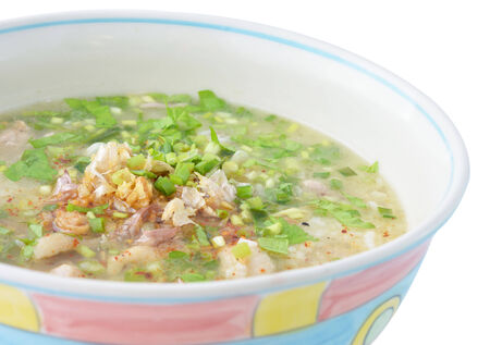 Rice porridge with pork and vegetable soup photo