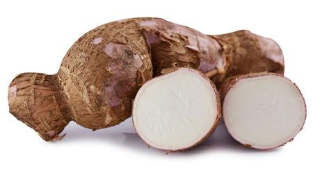 cutting and whole manioc (cassava) isolated on white background photo