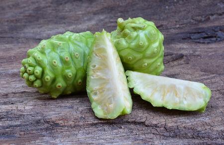 noni fruit: noni fruit on wood