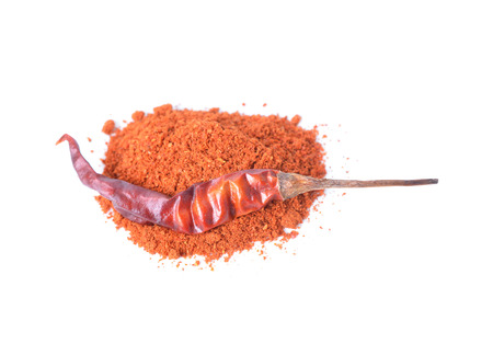 Dried red peppers and flakes  on white. Stock Photo
