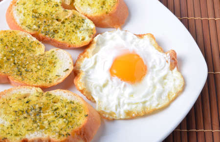 breakfast, garlic bread,fried egg photo