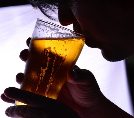 one man: One man is drinking a glass of beer