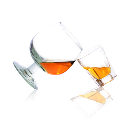 tipple: Whiskey in a shot glass and brandy isolated on a white background Stock Photo