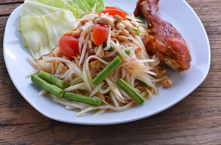 gill: papaya salad, som tum and gill chicken