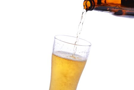 pouring beer: Pouring beer from bottle to stein Stock Photo