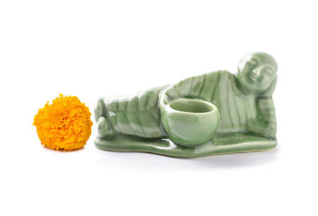 wean: Little Monk ceramic and Yellow marigold on a white background