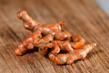 curcumin: turmeric on wooden background