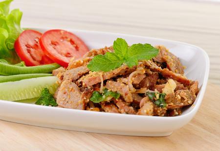 Thais eten, pittige varkensvlees met chili en mint Stockfoto