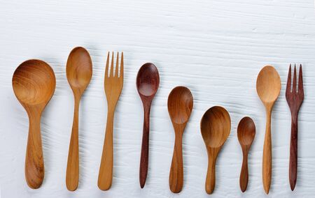 cooking implement: Wooden spoon and fork and wood board background Stock Photo