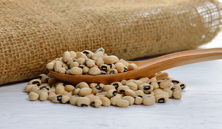 eyed: Black eyed peas close up on wooden table