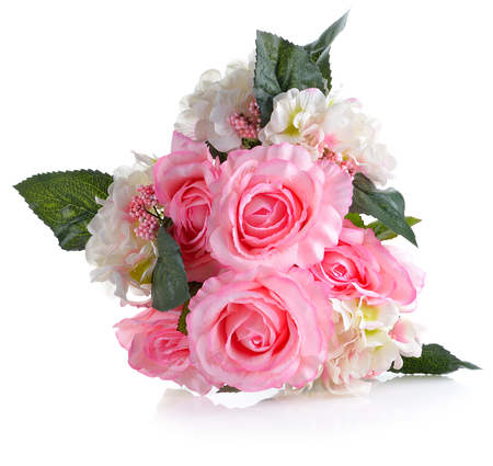 Artificial pink roses on white background