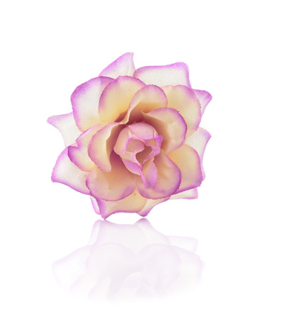Artificial rose isolated on a white background.