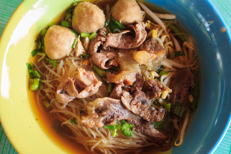 thicken: A Vintage noodle with meatballs , Braised Beef and Thicken Soup in thai style food
