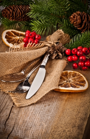 cutleries: Vintage silverware on rustic wooden background with christmas decoration  Stock Photo