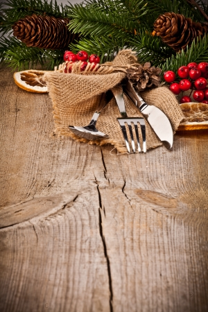 Vintage silverware on rustic wooden background with christmas decoration  photo
