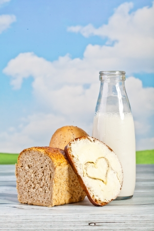 bread and milk in a bottle on a background of the sky - a picnic Stock Photo - 23350565