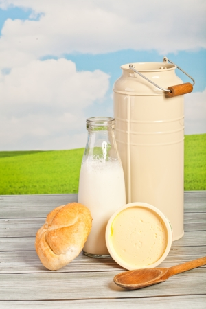 bread and milk in a bottle on a background of the sky - a picnic  photo