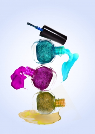 Bottles with spilled nail polish  photo