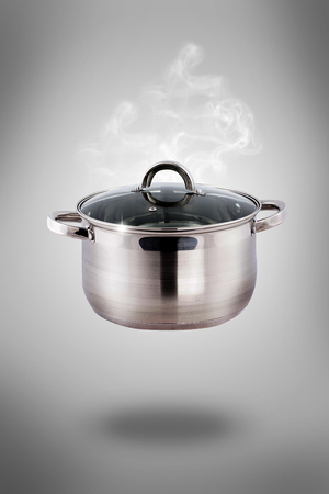Set of pots and pans - cooking vegetables with a pan - soup photo