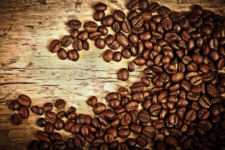 coffeetree: Fresh coffee beans on wood and linen bag, ready to brew delicious coffee