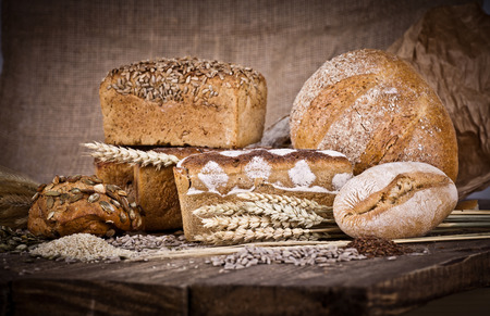 fresh bread and wheat on the wooden - rustic photo