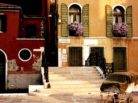 Old small street in italian town, sidewalk and old windows Stock Photo - 5556843