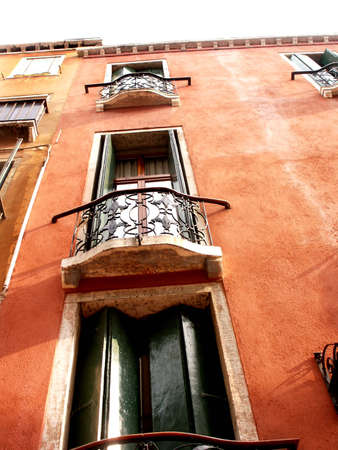Windows with wooden shutters on the red wall Stock Photo - 5639679