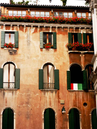 Italian windows with green shutters and flowers Stock Photo - 5639677