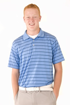 preppy: young redhead boy with blue eyes and blue polo shirt