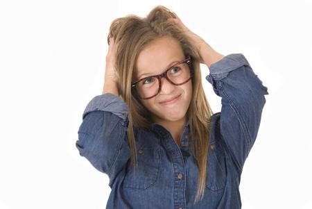girl playing with hair in denin shirt Stock fotó