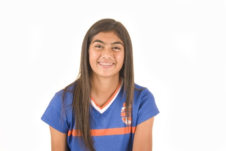 Young dark complected girl in football soccer jersey smiling with braces