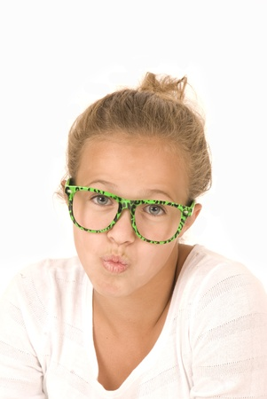 puckering: Young girl in trendy green glasses puckering Stock Photo