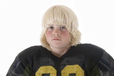 blonde boy in American football black jersey