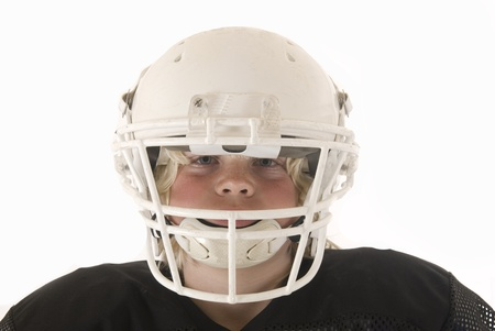 boy American football helmet and shoulder pads Stock Photo