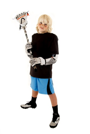 light complexion: Young boy in lacrosse outfit with stick