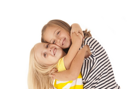 cute young girls giving each other hug