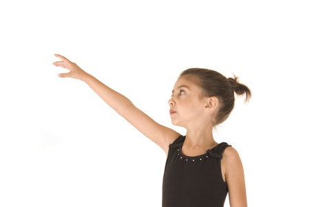 arm extended: young ballerina girl reaching for her dreams
