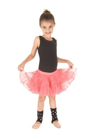 ballerina girl holding up her pink tutu photo