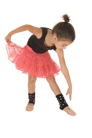 touching toes: young girl ballerina bending over touching toes