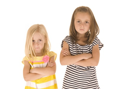 Two sisters arms folded angry not happy photo