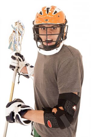 Intense male lacrosse player in uniform helmet photo