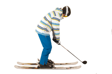 winter fashion: young man in ski outfit and golfing Stock Photo
