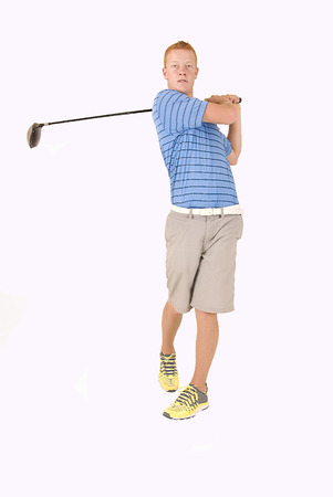 Redhead young man teeing off white background Stock Photo