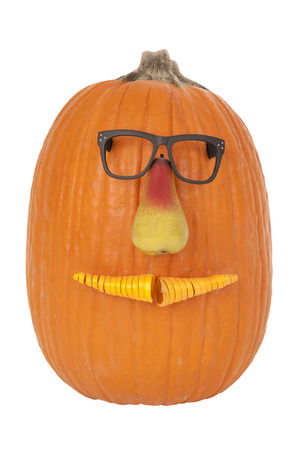 Cute pumpkin dressed up with funny face photo
