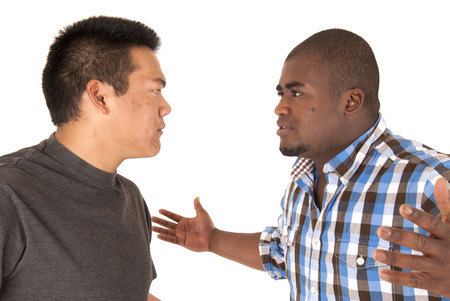 Brothers having an arguement with angry looks Stock Photo