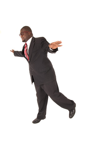 flying man: Black man in a business suit flying