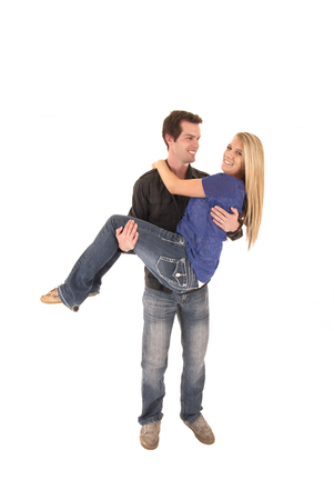 carrying: man carrying woman couple love holding happy Stock Photo