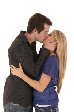 Side view of young couple kissing embrace