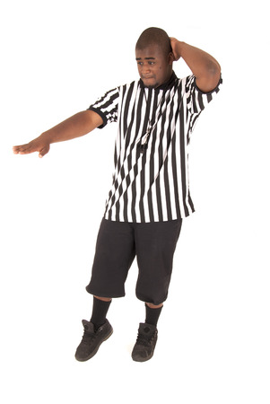 black basketball referee calling a charging foul