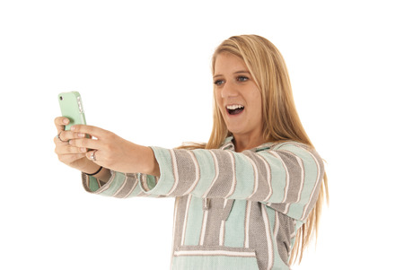 blonde woman taking selfie cell phone photograph